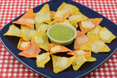 Nachos with tortilla chipsm cheee and guacalmole Royalty Free Stock Images
