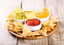 Nachos with various sauces Stock Photos