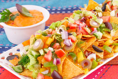 Nachos, vegetables and cheese sauce Stock Photos