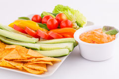 Nachos, vegetables and cheese sauce Stock Photo