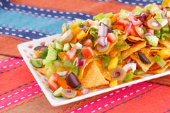 Nachos and vegetables Stock Images