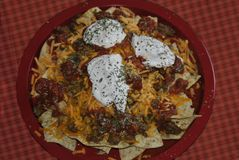Nachos. Yummy nachos on a red plate ready for some football Royalty Free Stock Photography