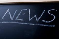 Nachrichten geschrieben auf eine Tafel Lizenzfreies Stockfoto