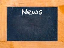 Nachrichtenzeit-Kreidebrett Lizenzfreie Stockfotos