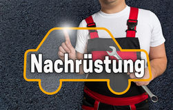Nachruestung (in german retrofit) touchscreen is operated by car Stock Images