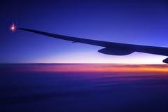 Nacht aan Dag in een Vliegtuig Stock Afbeelding