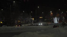 Nacht bokeh in de straat van Dimitrovgrad, Bulgarije