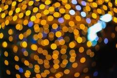 Nacht-helles goldenes abstraktes Weihnachten-bokeh bunter schöner Hintergrund: mit Kopienraum für addieren Sie Text Stockbilder