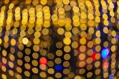 Nacht-helles goldenes abstraktes Weihnachten-bokeh bunter schöner Hintergrund: mit Kopienraum für addieren Sie Text Lizenzfreies Stockbild