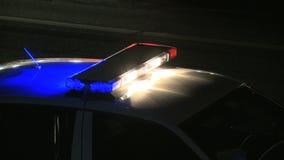 Nacht 1 2 van het politiewerk stock footage