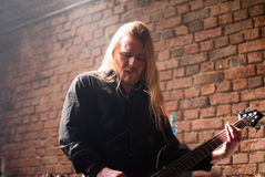 NACHTGESCHREI Oli on Bass. Bass guitar player of the German metal folk rock band NACHTGESCHREI at MATRIX in Bochum (4th of march 2011 stock photo