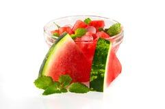 Nachtisch mit einer Wassermelone mit Broschüren der Minze. Stockbild