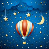 Nachtlandschaft mit Heißluftballon Stockfotos