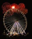 Nachtrad mit Feuerwerken Stockfotos
