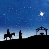 Nacimiento de Jesús de la natividad con la estrella en escena azul de la noche Foto de archivo libre de regalías