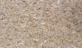 Naciskająca drewnianego panelu bezszwowa tekstura ukierunkowywająca pasemko deska - OSB obraz stock