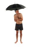 Nacked man with umbrella Royalty Free Stock Photography