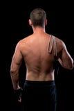 Nackter hinterer Athlet mit einem Springseil lokalisiert Lizenzfreies Stockbild