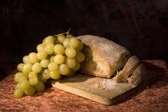 Naco e uvas do pão Imagens de Stock