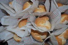 Nacos do pão italiano no saco da cera Fotos de Stock