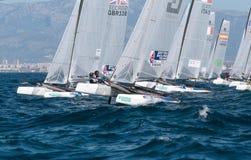 Nacra 17在赛船会期间的类航行在帕尔马起动线 库存照片