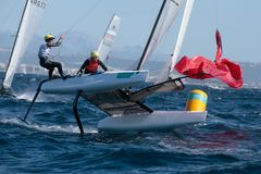 Nacra class french team sailing during regatta. Nacra class watercraft from France Tim Mourniac and Amelie Riou competing during the third day of the Princesa Royalty Free Stock Photography