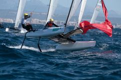 Nacra class french team sailing during regatta. Nacra class watercraft from France Tim Mourniac and Amelie Riou competing during the third day of the Princesa Stock Photo