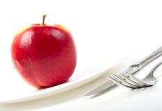 Naczynia i czerwony jabłko Obraz Stock