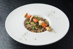 Naczynie z gryką i warzywami Fotografia Stock