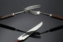 Nad-kniv för två gafflar Arkivfoto