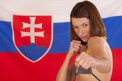 nad walczącą kobietą walcząca flaga Fotografia Stock