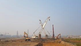 Nad widok na grupie budowy maszyneria parkuje przy placem budowy Obraz Royalty Free