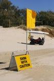 Nadada com sinal do cuidado Foto de Stock Royalty Free