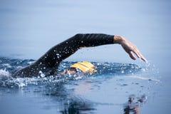 Nadador desconocido en el mar Imagen de archivo