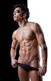 Nadador mojado atractivo en puesto en los vidrios Fotografía de archivo libre de regalías