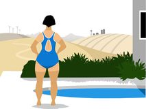 Nadador que se coloca al lado de una piscina exterior Imágenes de archivo libres de regalías