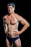 Nadador que se coloca con la mano en cadera Foto de archivo libre de regalías