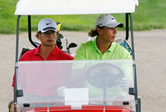Nadal in golf car. Spain tennis player rafa nadal (R) and his sparring tennis friend Tomeu Salva seen on a golf car while playing golf on a course near his Stock Photo