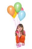 Nadenkend meisje met ballons Royalty-vrije Stock Afbeeldingen