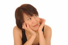 Nadenkende Aziatische vrouw Royalty-vrije Stock Afbeelding