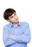 Nadenkende jonge mens Stock Afbeelding