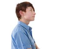 Nadenkende jonge mens met doordringen - geïsoleerd op wit stock foto's