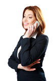 Nadenkende onderneemster die op de telefoon spreken Royalty-vrije Stock Foto's