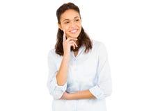 Nadenkende vrouw met vinger op kin Royalty-vrije Stock Afbeelding