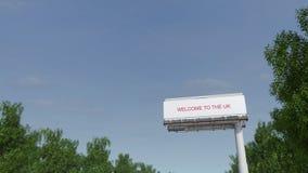 Naderbij komend groot wegaanplakbord met Onthaal aan de Britse titel het 3d teruggeven Stock Fotografie