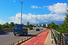 Nadezhda overpass Sofia Bulgaria. Moving vehicles and new bicycle track on Nadezhda overpass in Sofia city Bulgaria,Vitosha mountain in the distance Stock Images