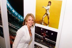 Nadia Comaneci. Olympic gymnast Nadia Comaneci next to a picture of herself 40 years ago at the 1976 Montreal,Olympic games Royalty Free Stock Photography