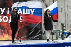 Nadia Tolokonnikova, and Masha Alekhina (Pussy Riot) on the peace March in support of Ukraine. MOSCOW, RUSSIA - March 15, 2014: Nadia Tolokonnikova, and Masha Stock Photos