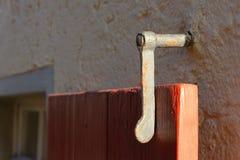 nadokienni żaluzja kędziorki i drzwiowe rękojeści zdjęcia stock