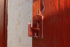 nadokienni żaluzja kędziorki i drzwiowe rękojeści fotografia royalty free